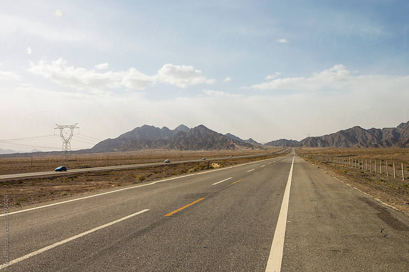 road in Gobi desert by Bo Bo for Stocksy United