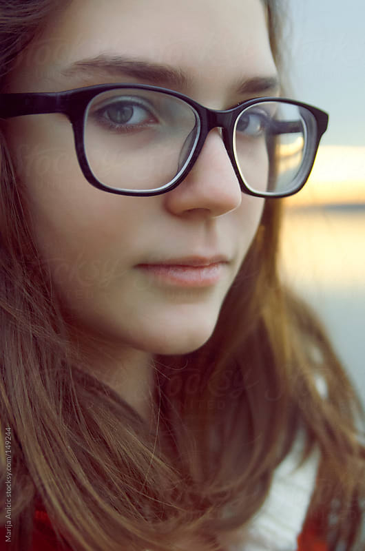 Portrait of young girl with glasses,close up by Marija Anicic for Stocksy United