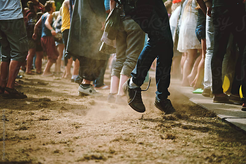 A youngster dancing in dust at a summer festival by Tõnu Tunnel for Stocksy United