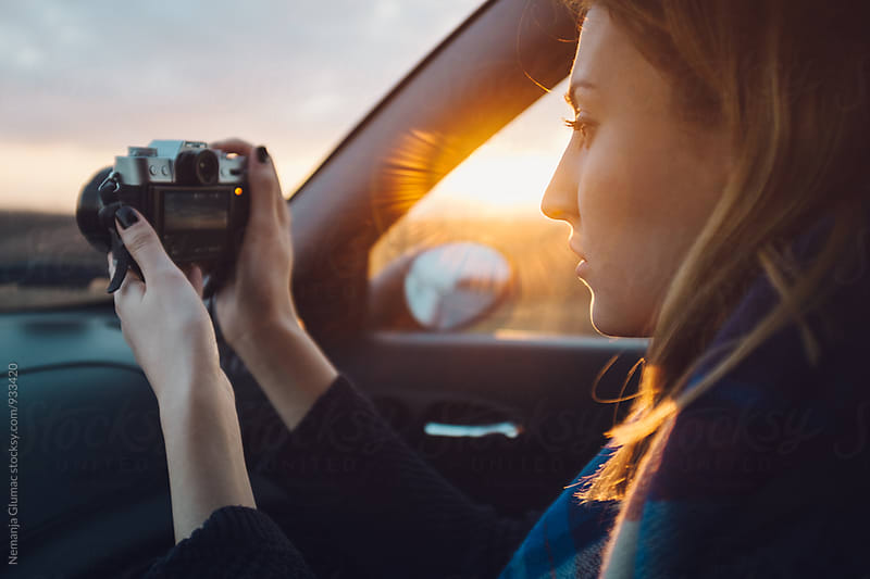 Pretty Woman Taking Photos While Traveling by Car by Nemanja Glumac for Stocksy United