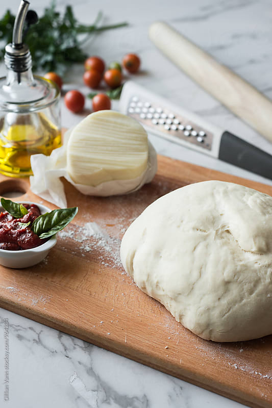 pizza dough and ingredients ready for pizza by Gillian Vann for Stocksy United
