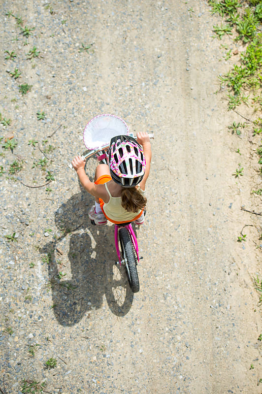 Girl Riding Bike on Path (Overhead View) by Brian McEntire for Stocksy United
