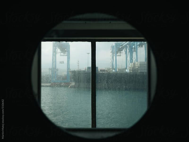 framed View at dock cranes from ferry by Martin Matej for Stocksy United