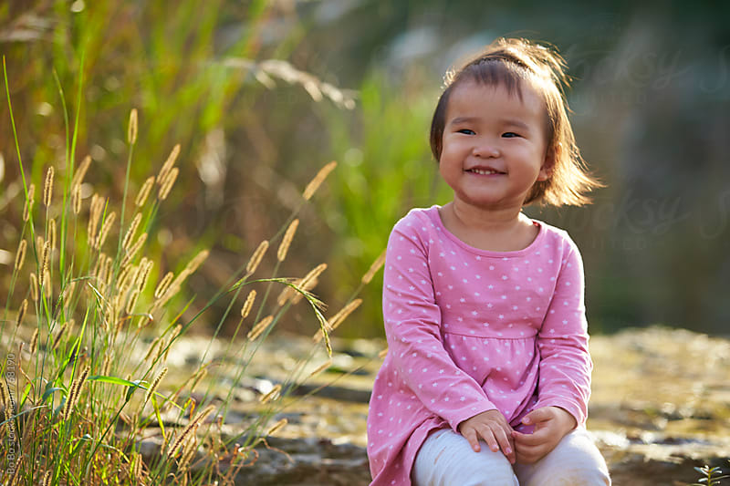 happy asian little girl outdoor by cuiyan Liu for Stocksy United