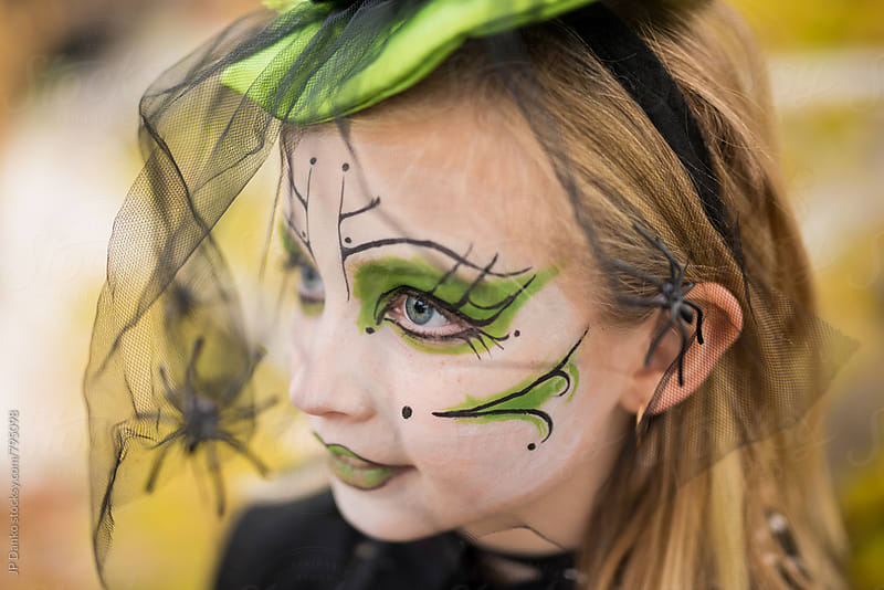 Little Girl Dressed Up As A Witch For Halloween Face Paint Make Up by JP Danko for Stocksy United