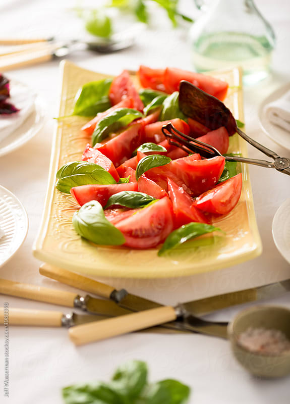 Tomato Salad with Basil on Table by Jeff Wasserman for Stocksy United
