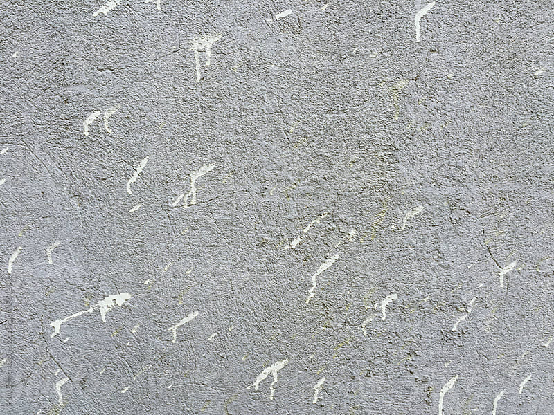 White paint splatter on grey wall, close up by Paul Edmondson for Stocksy United