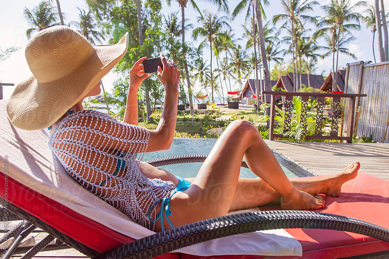Pretty Woman in Bikini Taking Holiday Photo With Phone by VISUALSPECTRUM for Stocksy United