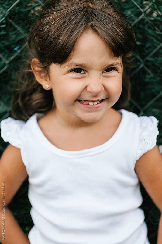 Portrait of a Funny Little Girl Laughing by Victor Torres for Stocksy United