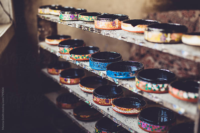 Kashmiri handicrafts on a shelf in a rustic workshop by Maresa Smith for Stocksy United