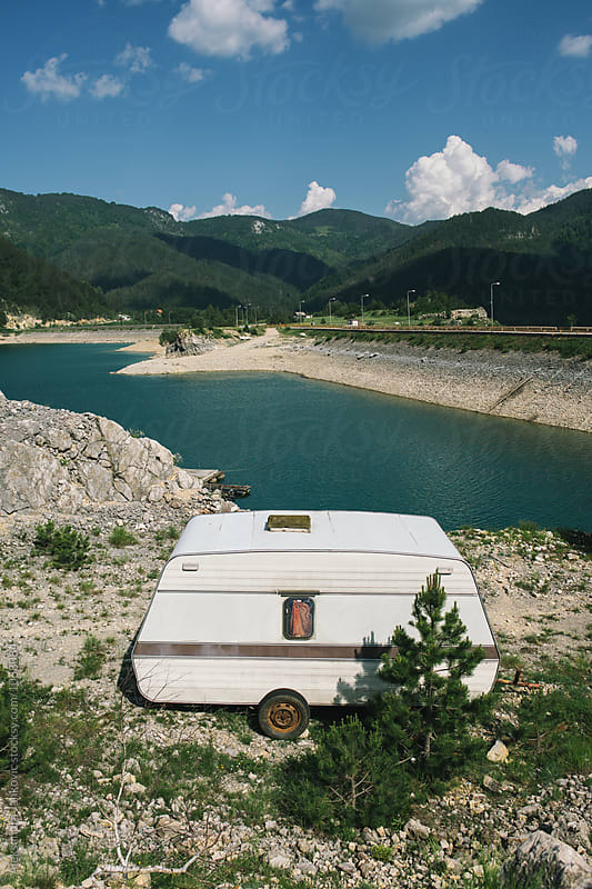 RV Trailer Parked by the Lake by Aleksandra Jankovic for Stocksy United