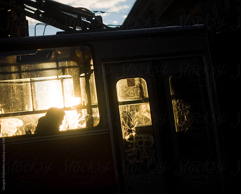 Sunset glowing thru dirty windows. by Gergely Kishonthy for Stocksy United