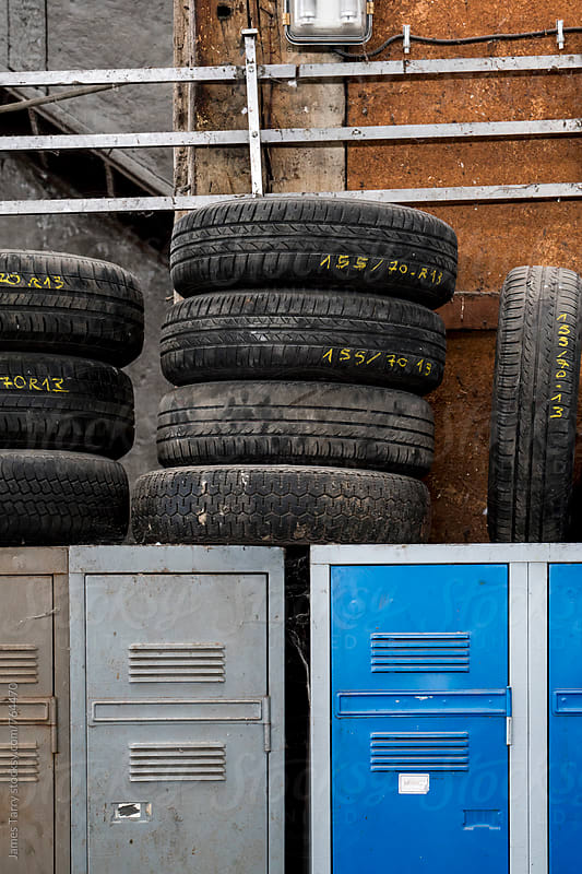 Tyres and old lockers by James Tarry for Stocksy United