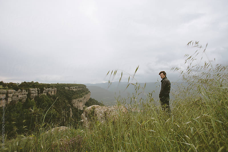 Young modern man on the top of the mountain. by BONNINSTUDIO for Stocksy United