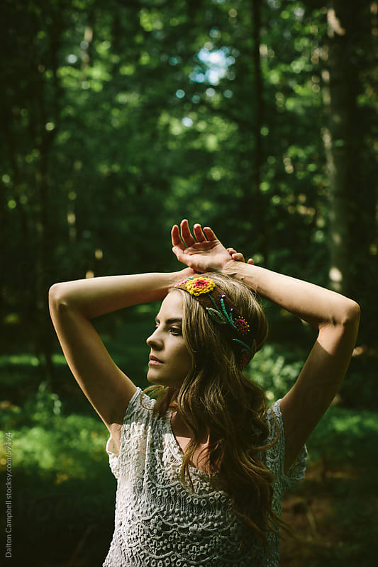 Girl standing in forest with headband on by Dalton Campbell for Stocksy United