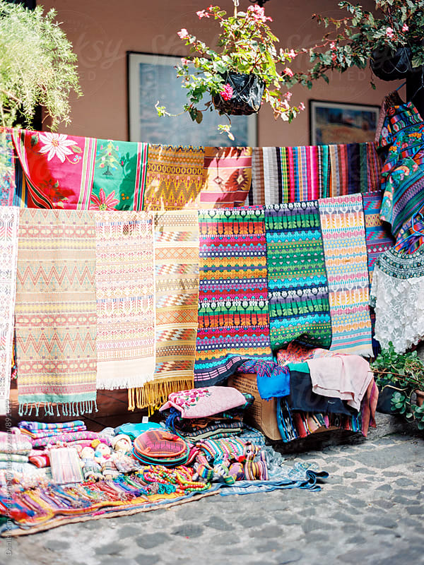 Colorful textiles at a market by Daniel Kim Photography for Stocksy United