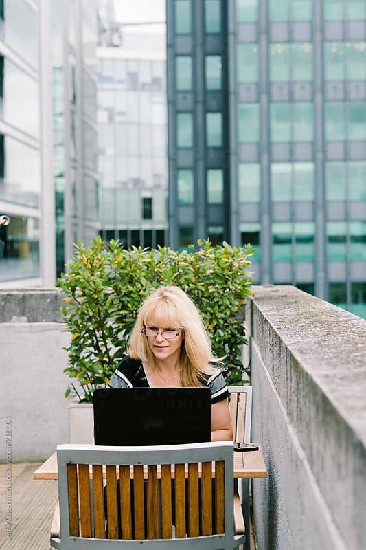 Business Woman on Computer on Terrace by Jeff Wasserman for Stocksy United