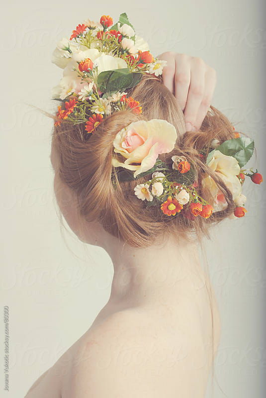 Flowers in hair by Jovana Vukotic for Stocksy United