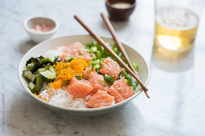 Salmon poke bowl  by Ivan Solis for Stocksy United
