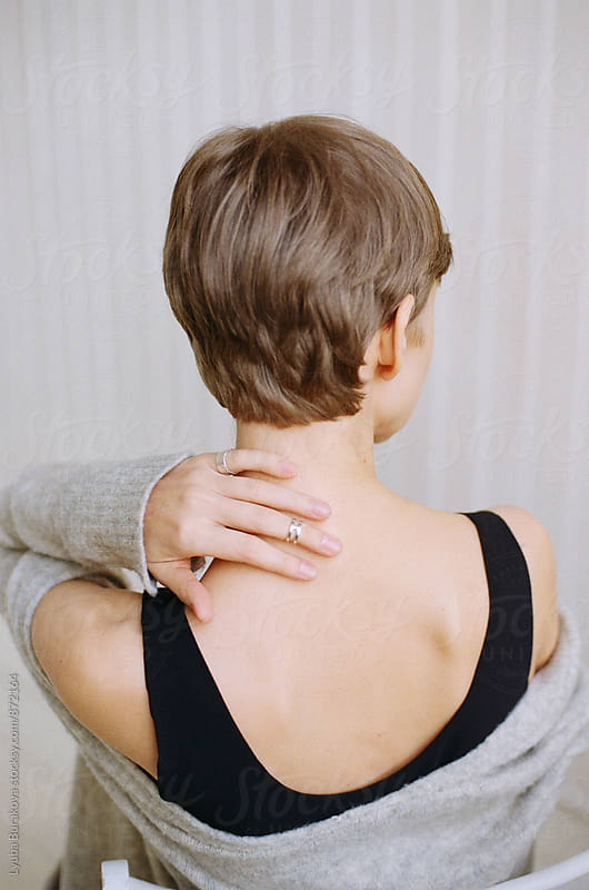 Back view o a woman with short haircut by Lyuba Burakova for Stocksy United