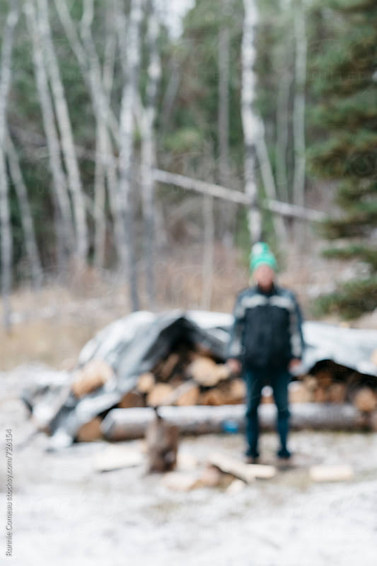 Blurred Lumberjack by Ronnie Comeau for Stocksy United