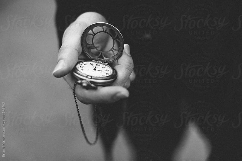 Hand Holding Pocket Watch in Black and White by Briana Morrison for Stocksy United