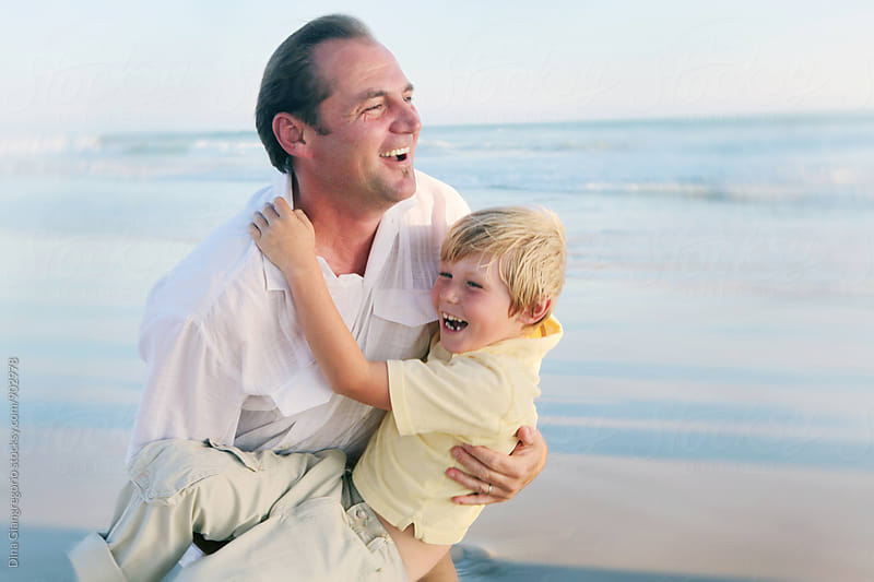 Father Playing With Son at the Beach by Dina Giangregorio for Stocksy United