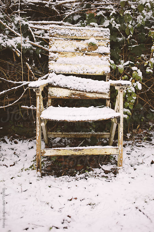 Rundown garden chair covered with snow by Marcel for Stocksy United