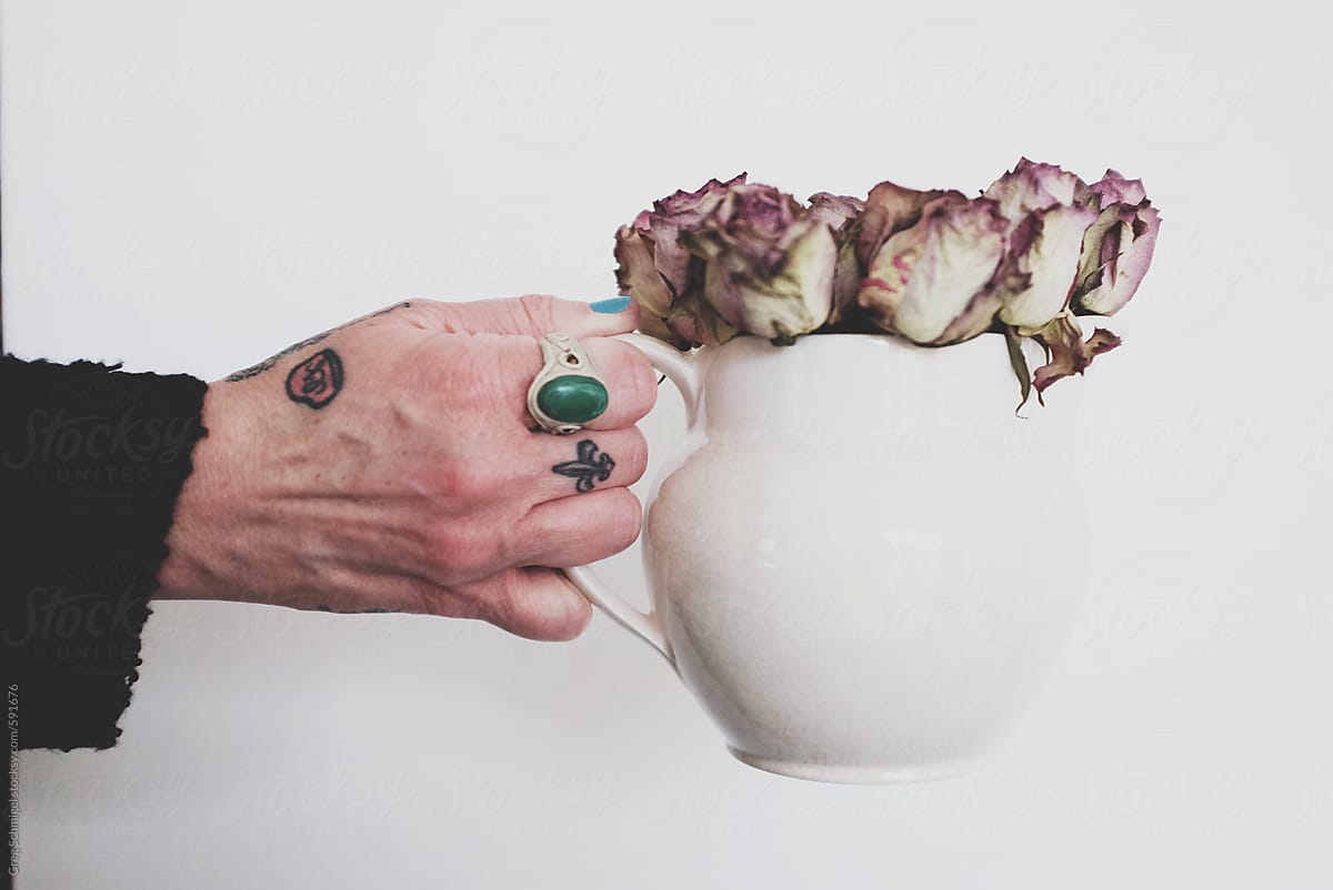 Tattoo Hand Holding Dried Flowers Roses In A White Water Pitcher Jug