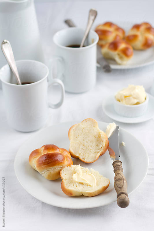 Breakfast rolls with butter and coffee by Noemi Hauser for Stocksy United