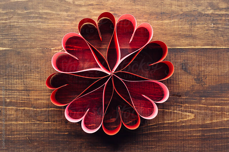 Heart shaped paper wreath from above by Gabriel (Gabi) Bucataru for Stocksy United
