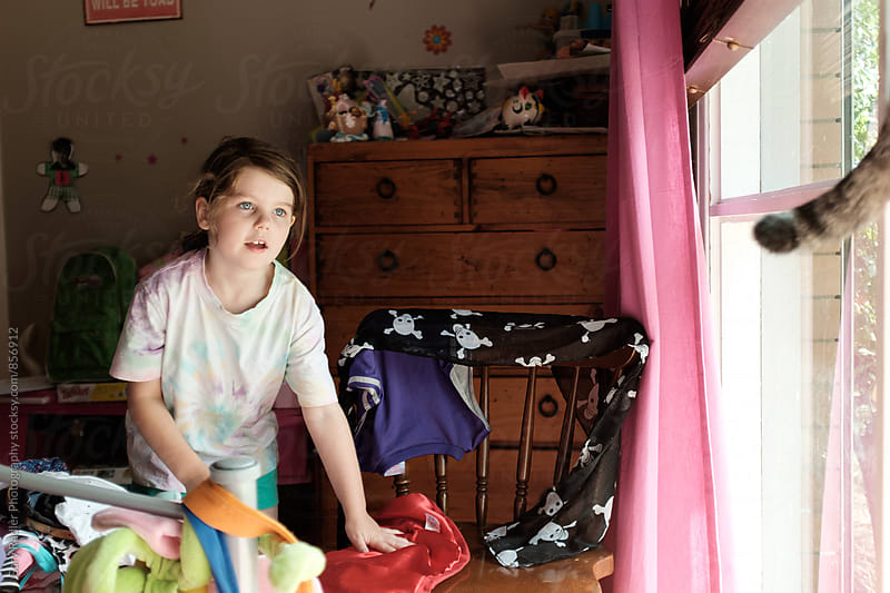 Little Girl in her Room Chasing a Cat by Gary Radler Photography for Stocksy United