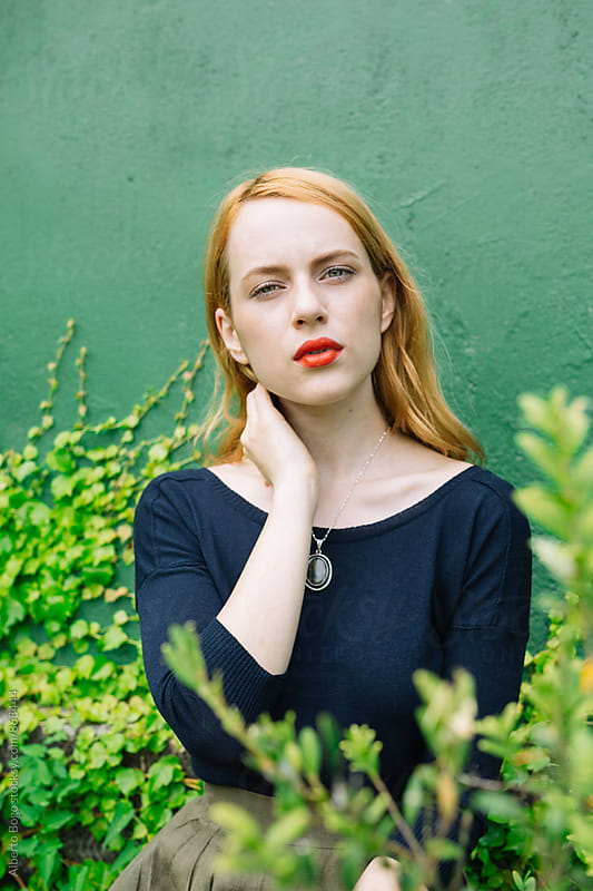 Close-up of red-haired young woman by Alberto Bogo for Stocksy United