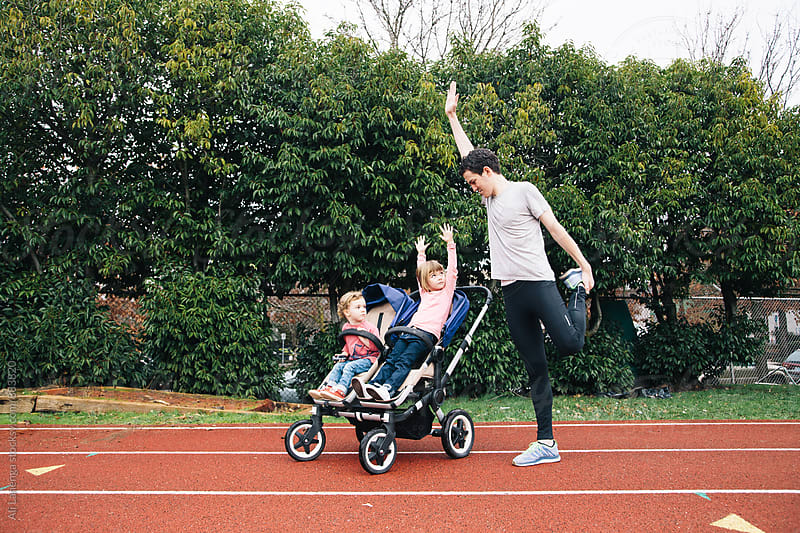 Stretching with Dad by Ali Lanenga for Stocksy United