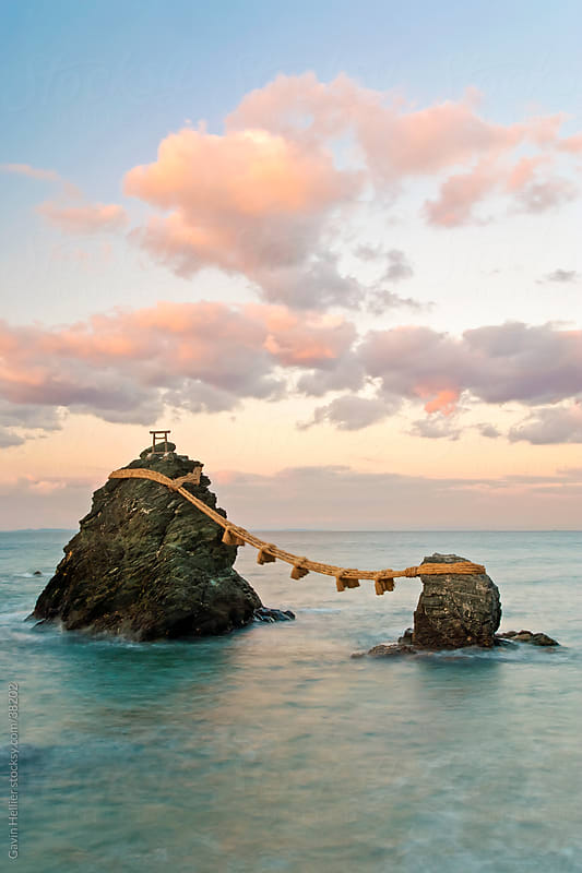 Japan, Central Honshu (Chubu), Ise-Shima, Futami, Meoto-Iwa (Wedded Rocks), these two rocks are considered to be male and female and have been joined in matrimony by shimenawa (sacred ropes), which are renewed in a special festival each year by Gavin Hellier for Stocksy United
