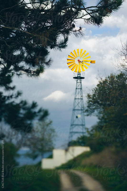 Old yellow windmill by CACTUS Blai Baules for Stocksy United
