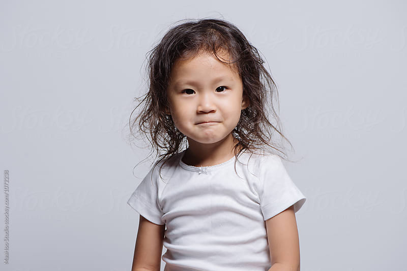 Studio shot of young Asian girl by Maa Hoo for Stocksy United