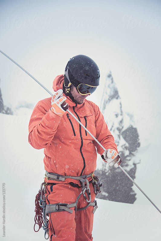 young male freeskier is holding an avalanche probe by Leander Nardin for Stocksy United