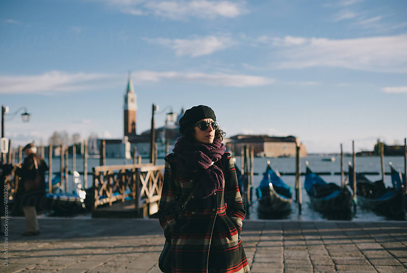 Young woman walking in St. Mark's Square in Venice by Davide Illini for Stocksy United