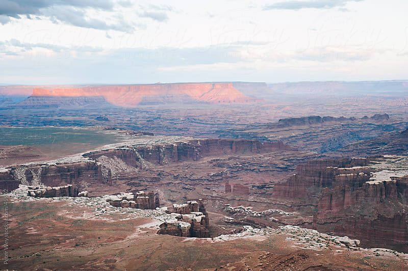Distant canyons in canyonlands national park at sunset by Peter Wey for Stocksy United