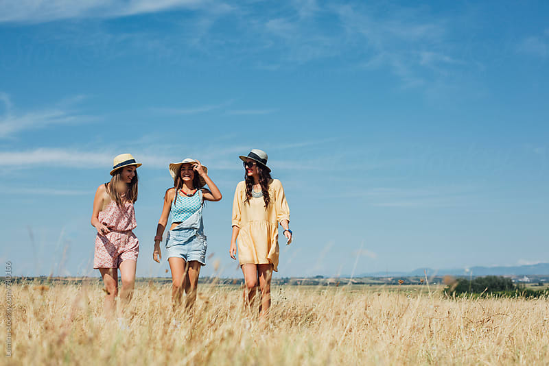 Three Girls Hiking Together by Lumina for Stocksy United