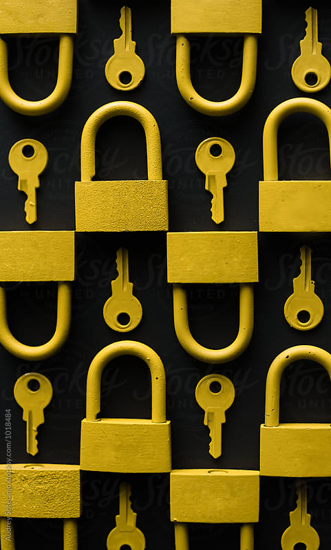 keys and lock.black/yellow by Marko Milanovic for Stocksy United