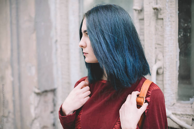 Portrait of young woman with blue hair by Alexey Kuzma for Stocksy United