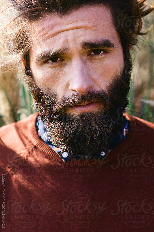 Closeup portrait of a bearded man in the forest. by BONNINSTUDIO for Stocksy United
