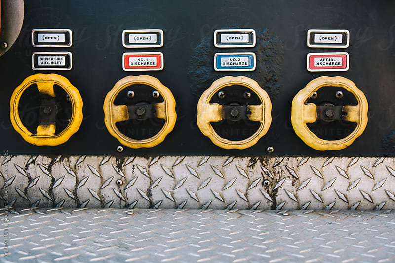 Water Valves on a fire engine by Gabriel (Gabi) Bucataru for Stocksy United