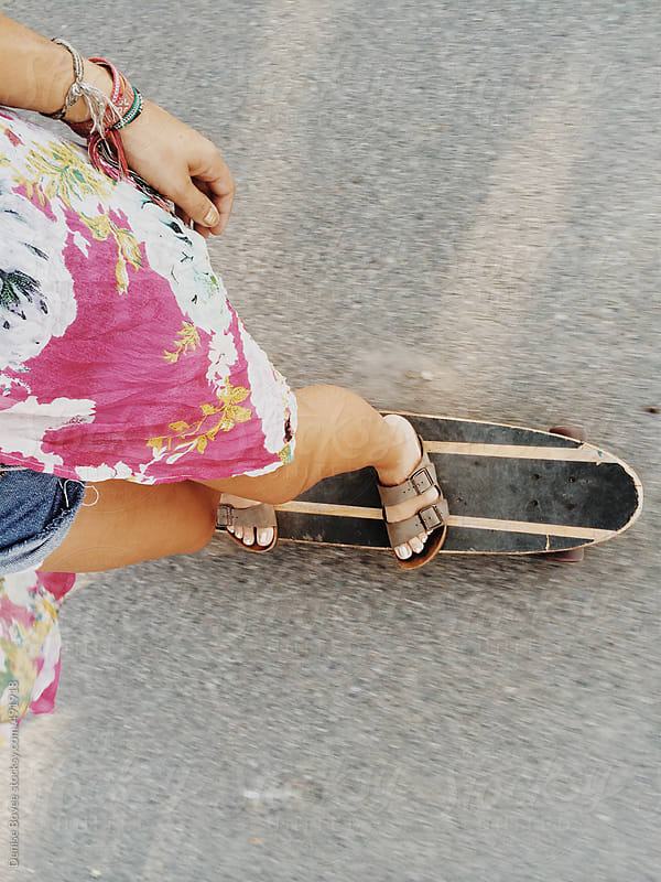 Woman Riding a Longboard by Denise Bovee for Stocksy United