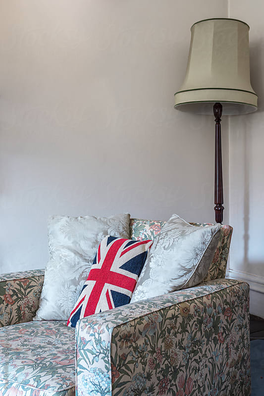 Union Jack cushion on an armchair in a seniors sitting room corner. by Paul Phillips for Stocksy United