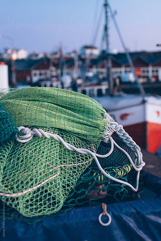 Fishing gear on the dock by Jonas Räfling for Stocksy United