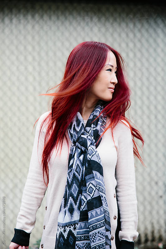Asian female with striking red hair by Curtis Kim for Stocksy United