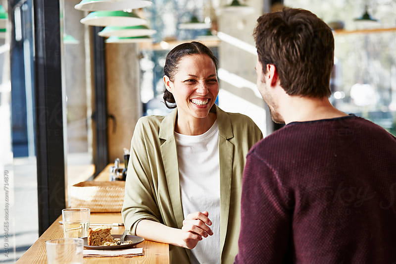 Businesswoman With Male Colleague In Restaurant by ALTO IMAGES for Stocksy United
